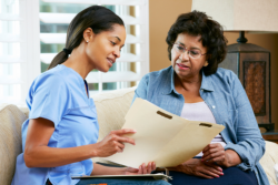 Nurse giving advice to the old woman